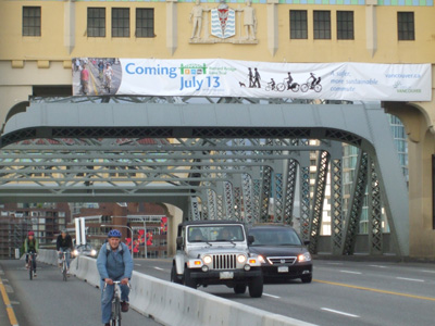 Banner advertising the Burrard Bridge Lane Re-allocation