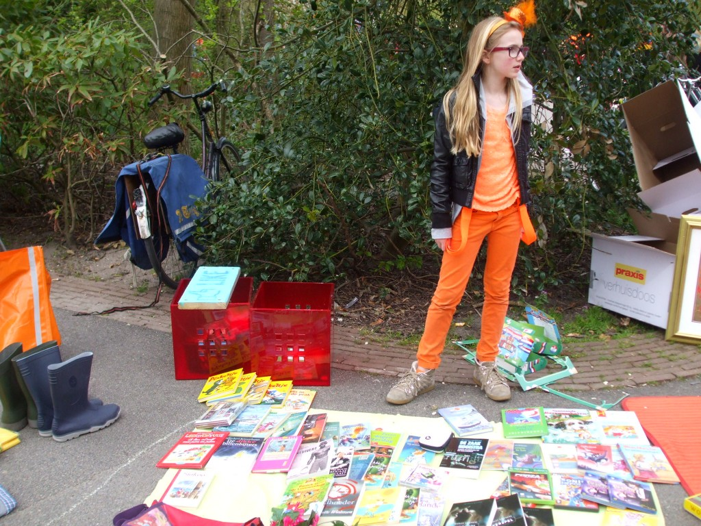 A girl sells her books in the Vondelpark