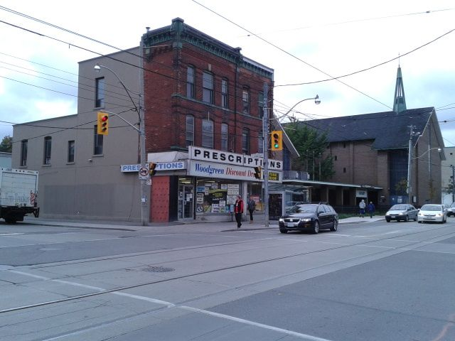Queen and Coxwell has vestiges of the past, but the pedestrian realm is barren here