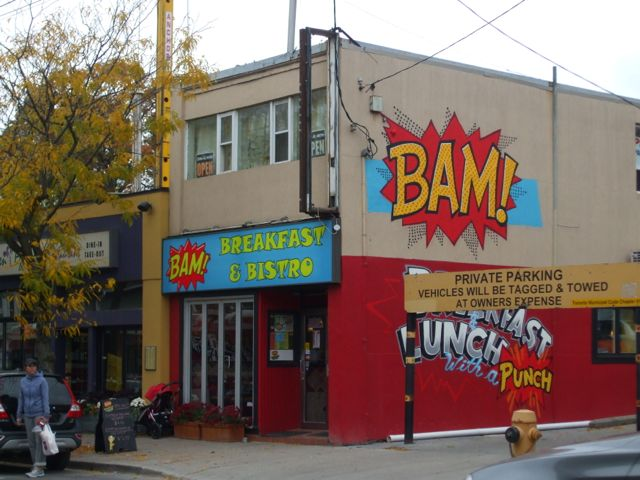 Bam! Breakfast and Bistro displays one of many colourful murals along Queen Street East