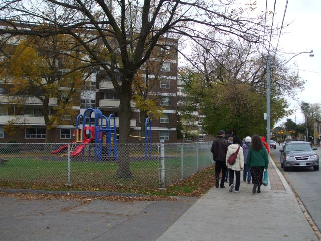 Playground and chain link fence protecting the private realm at Queen and Craven